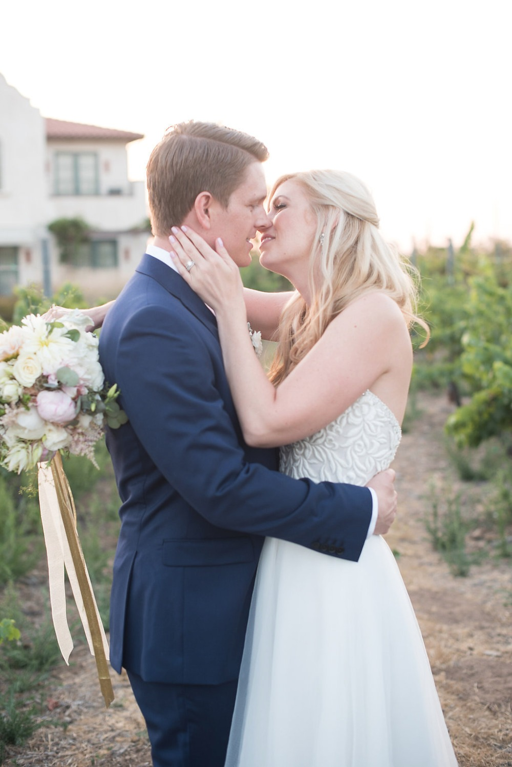 wedding kiss as the sunsets