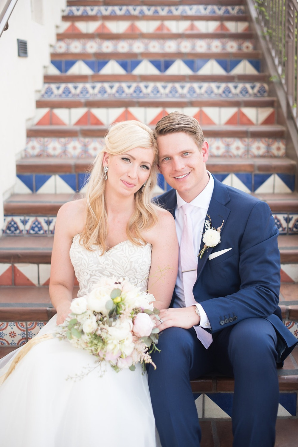 bride and groom in a stairwell