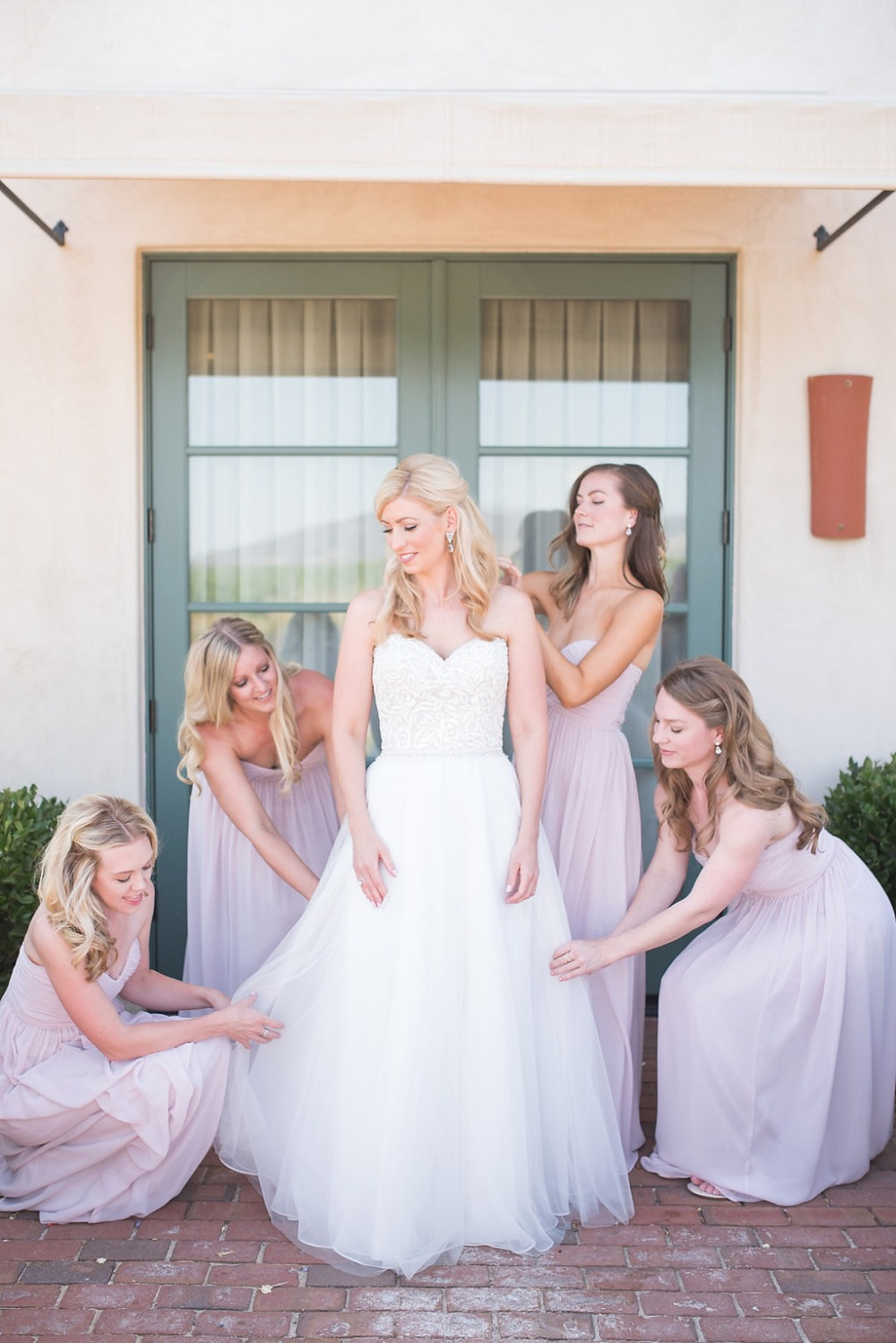 the bride in a beautiful Madison James wedding dress