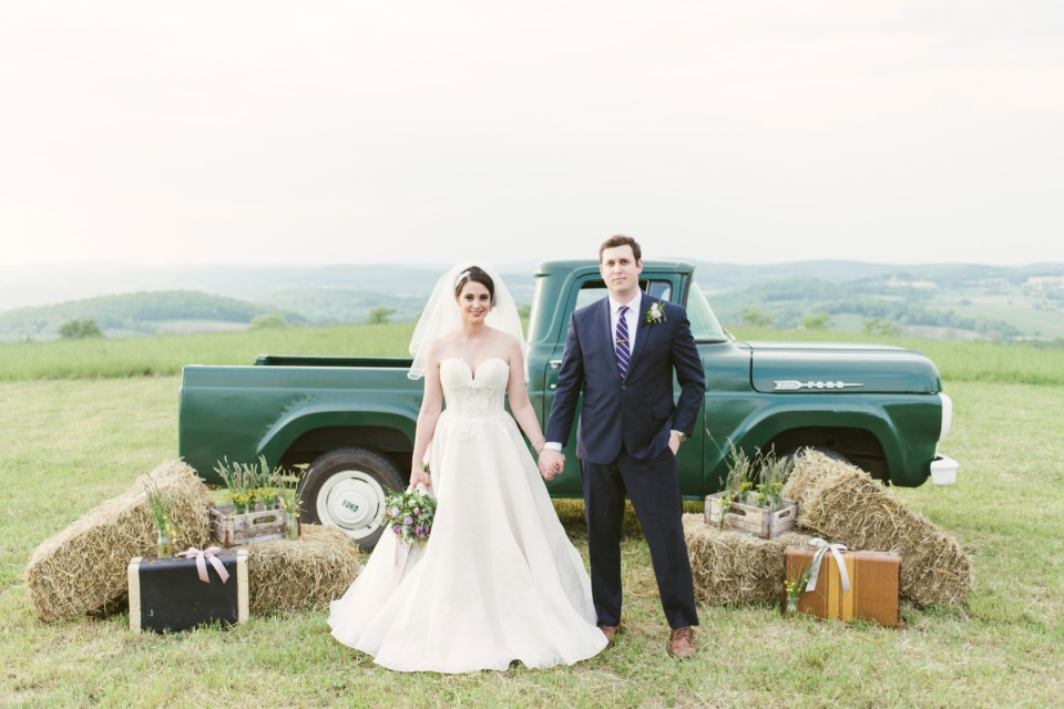 vintage pickup and hay bale wedding backdrop