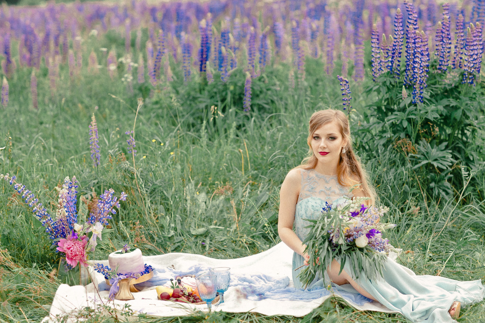 vow renewal picnic in a lupine field