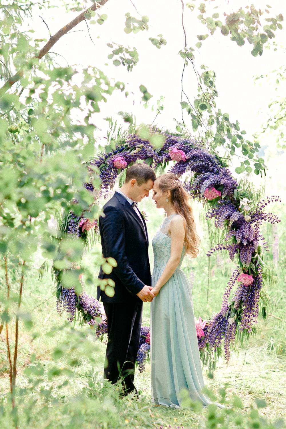vow renewal with floral backdrop
