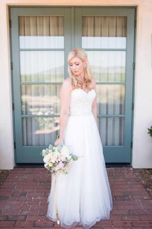 the blushing bride in her Madison James dress