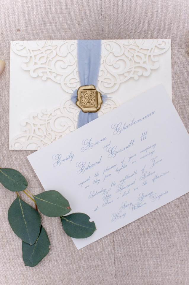 gold and blue laser cut wedding invitations with wax seal