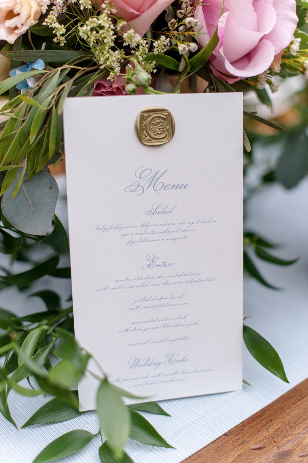 wax seal wedding menu in blue calligraphy