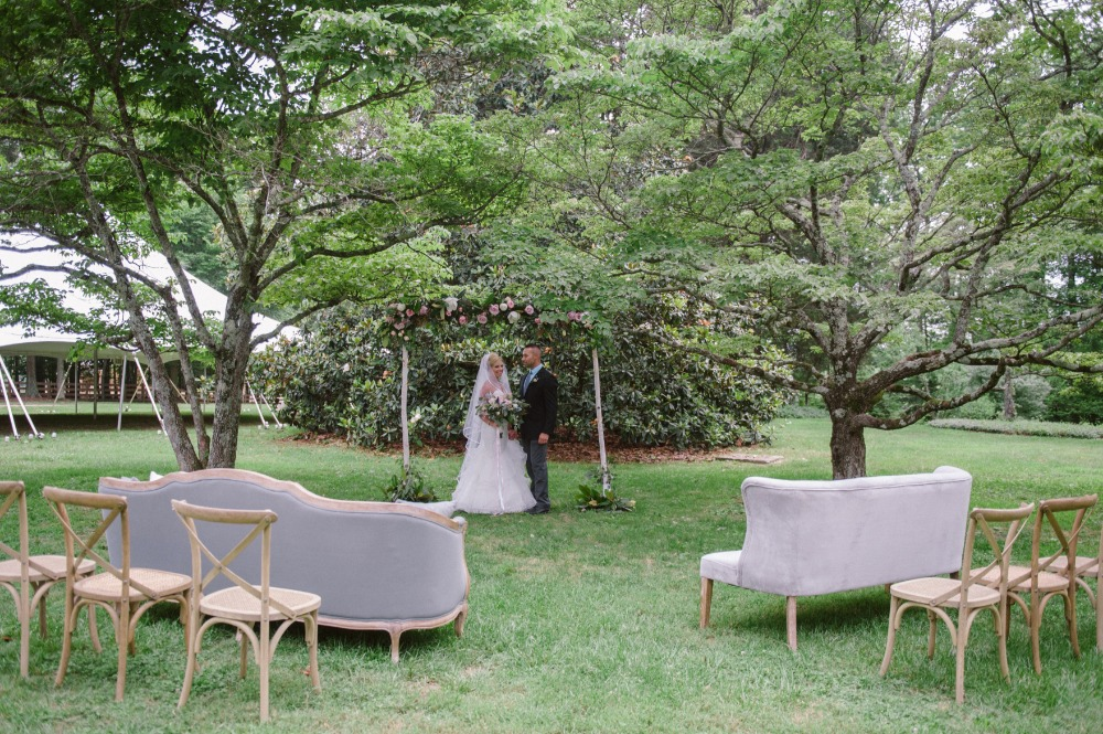 couches and cross back chair outdoor ceremony seating
