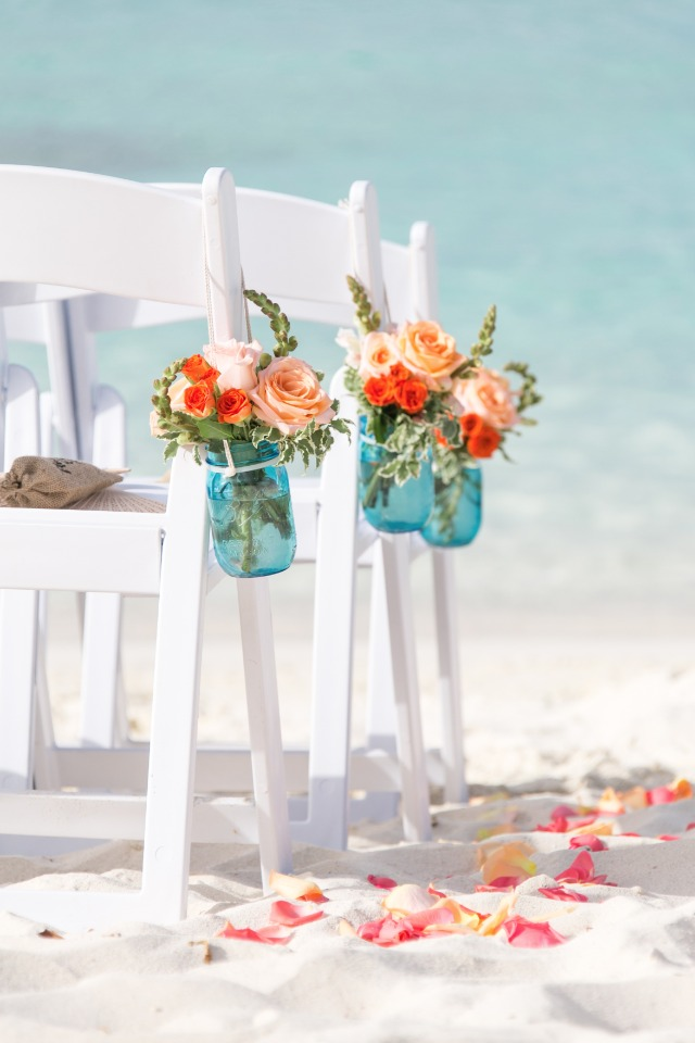 blue and orange floral aisle decor
