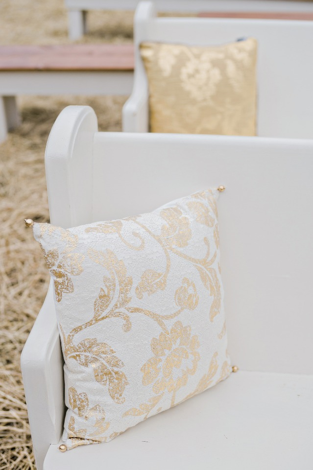 soften up those hard pews with a few gold and white accent pillows