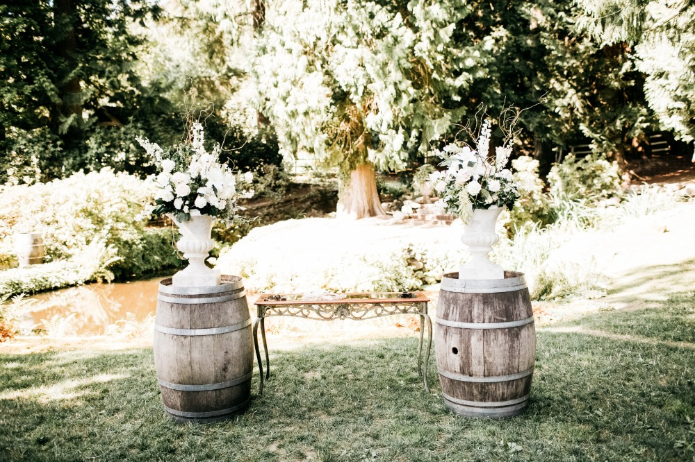 Whiskey barrel decor with large floral arrangements