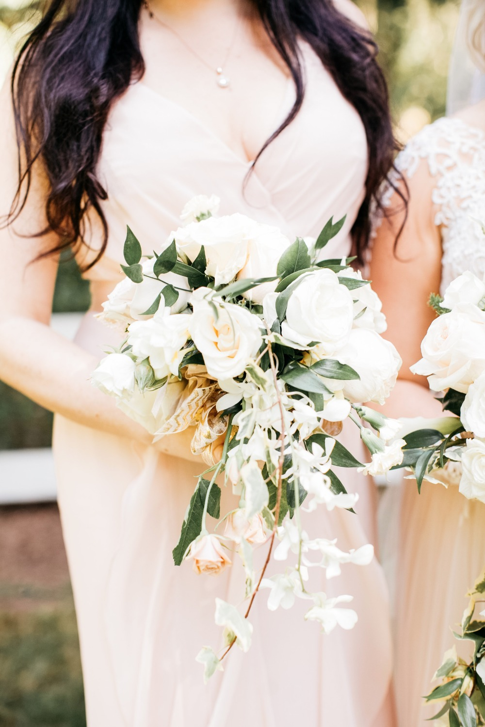 Blush dress and white bridesmaid bouquet