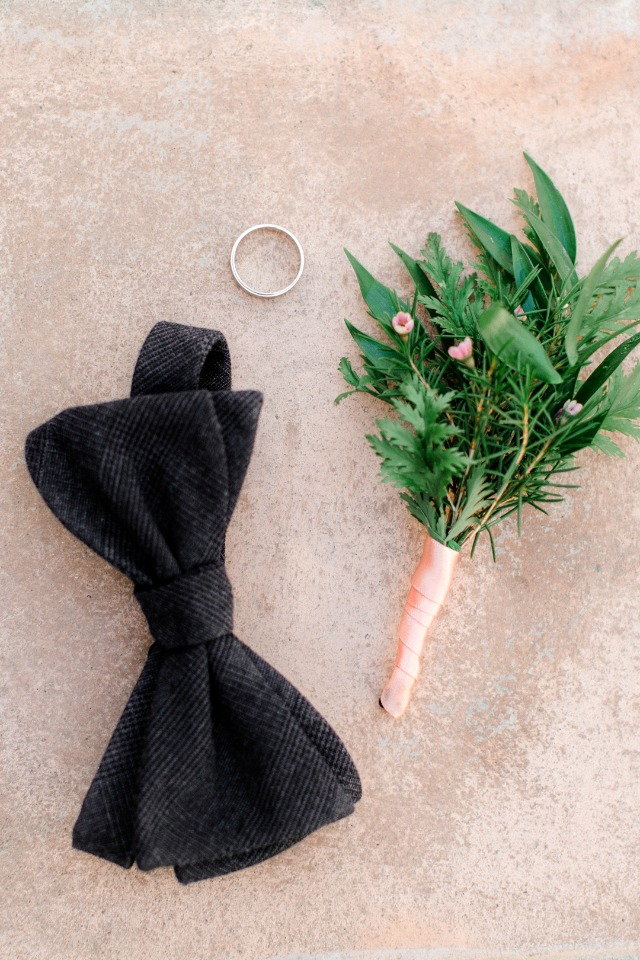 black bow tie and organic boutonniere