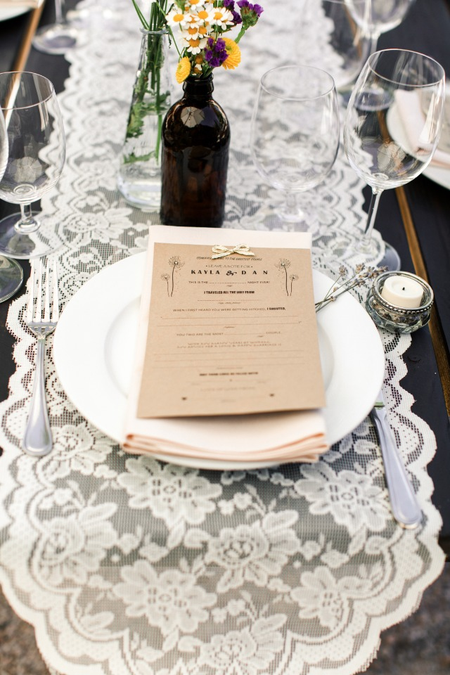 lace table runner and brown paper thank you note at your place setting