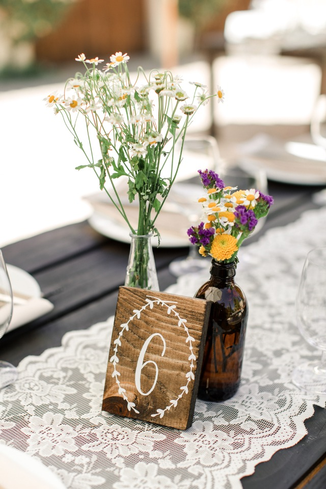 wooden block table number and wild flower centerpiece