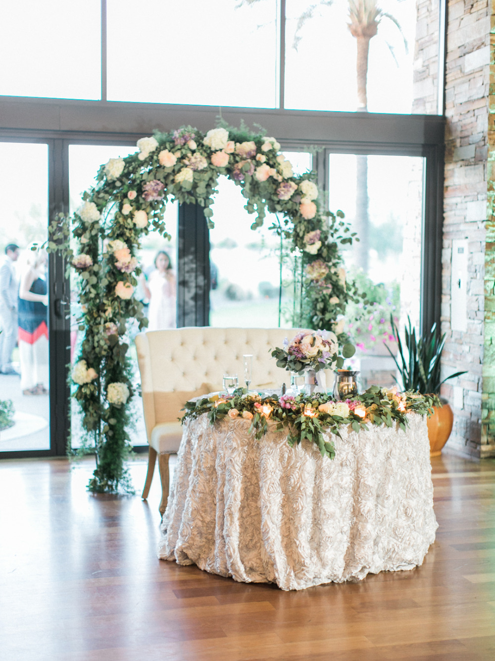 sweetheart table with flower arch