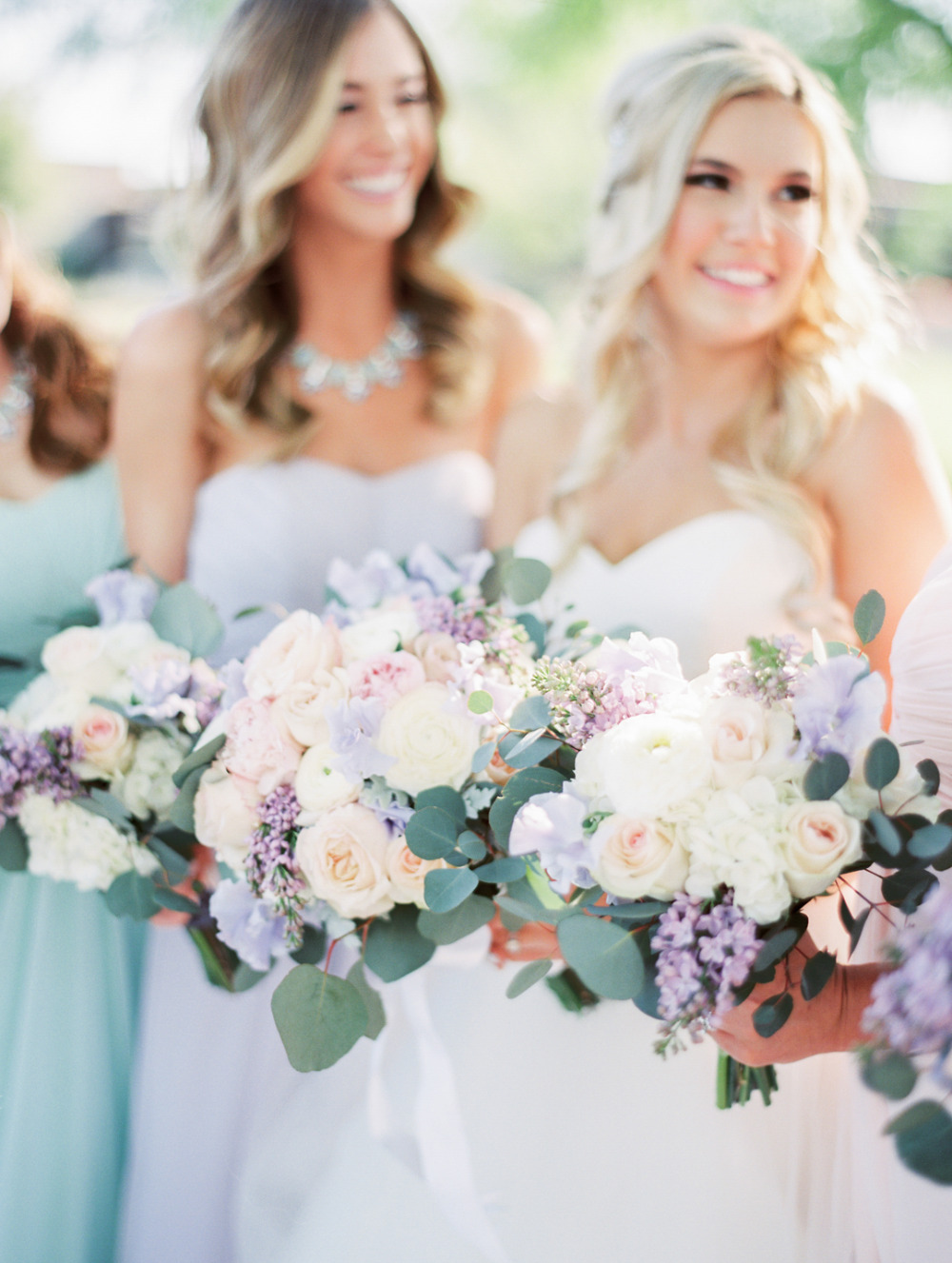 pretty purple pink and white wedding bouquets
