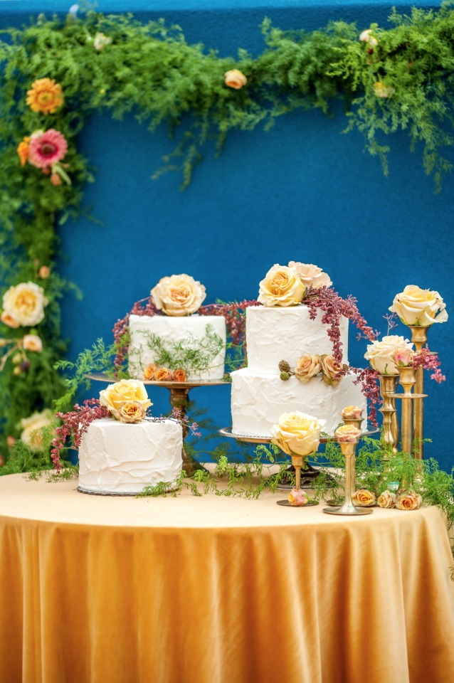 multi level cake table in gold and royal blue