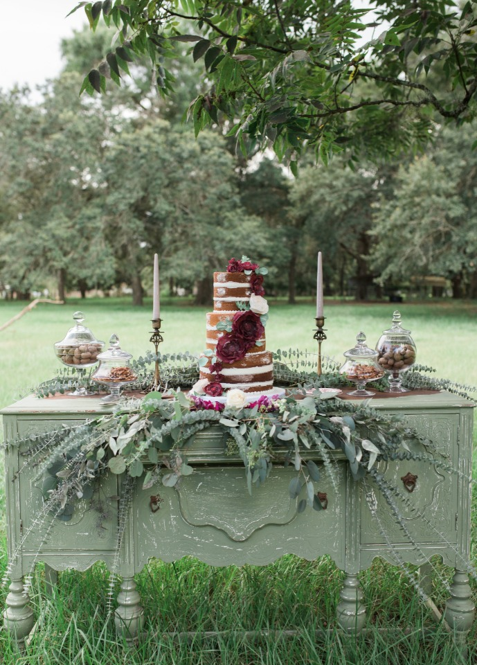 purple and sage green wedding cake table