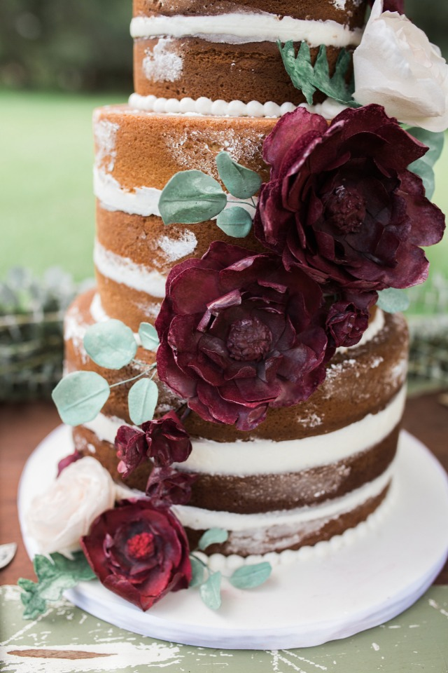 naked wedding cake with edible floral accents