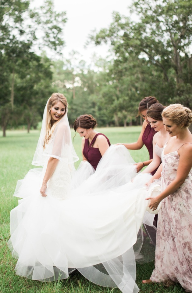 helping the bride with her train