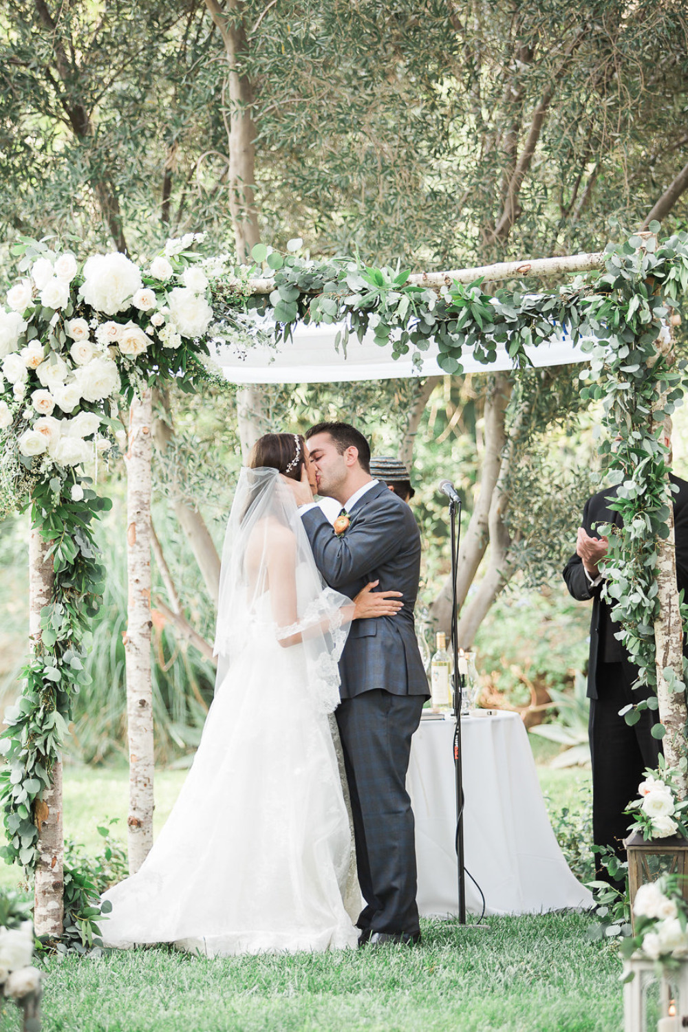 beautiful floral and birch wedding chuppah