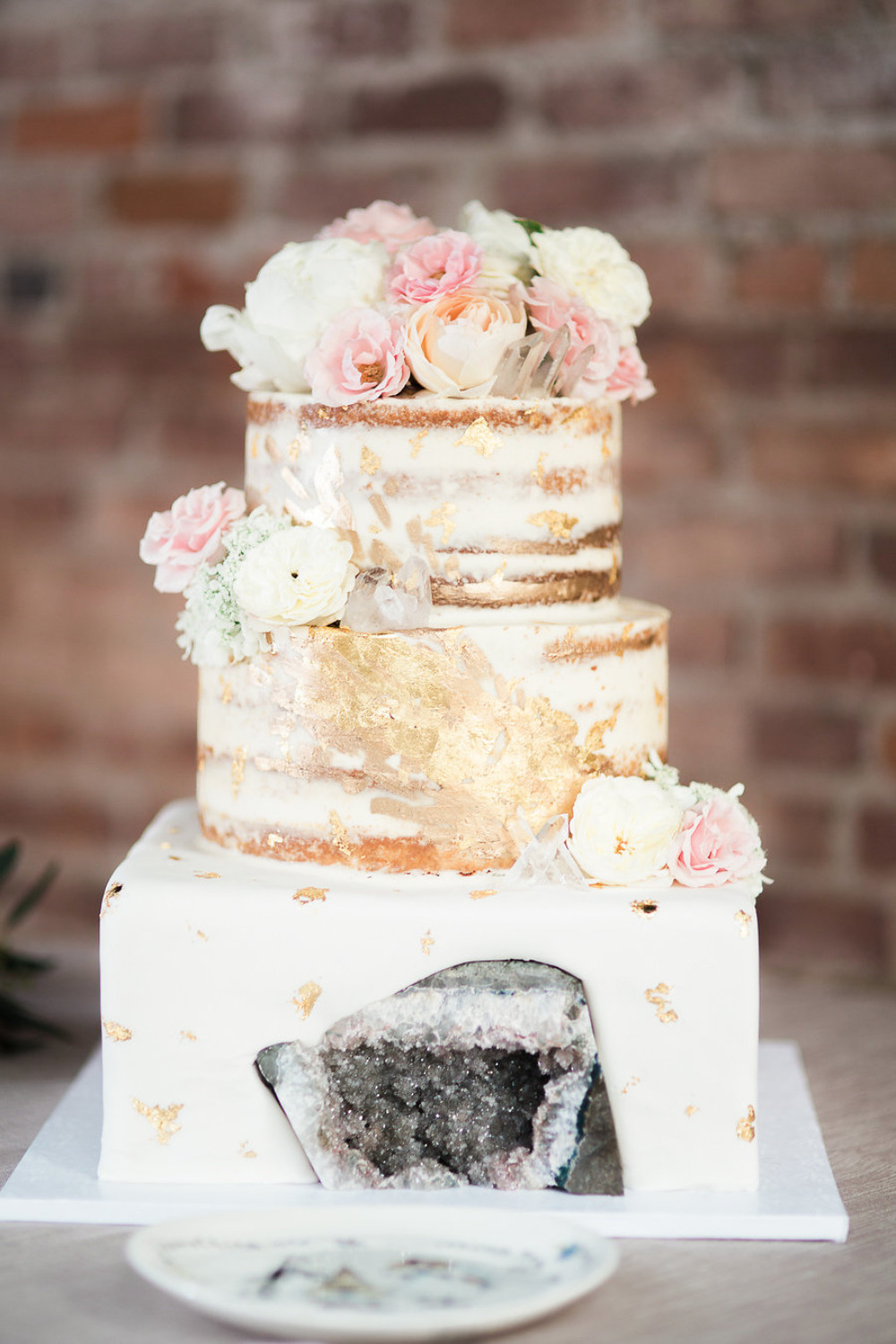 naked wedding cake with gold foil and geode