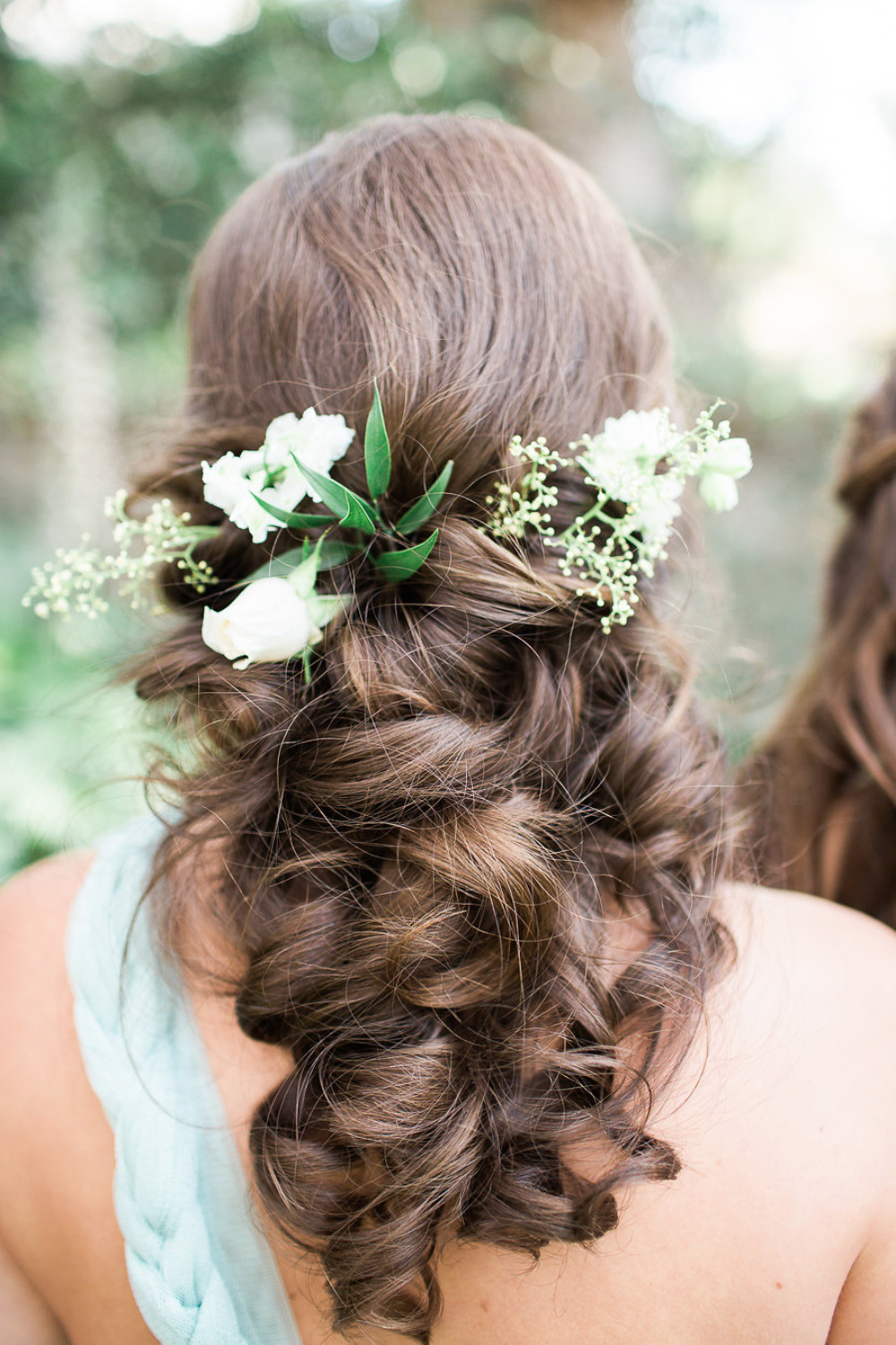 beautiful curled wedding bridesmaids hair with flowers