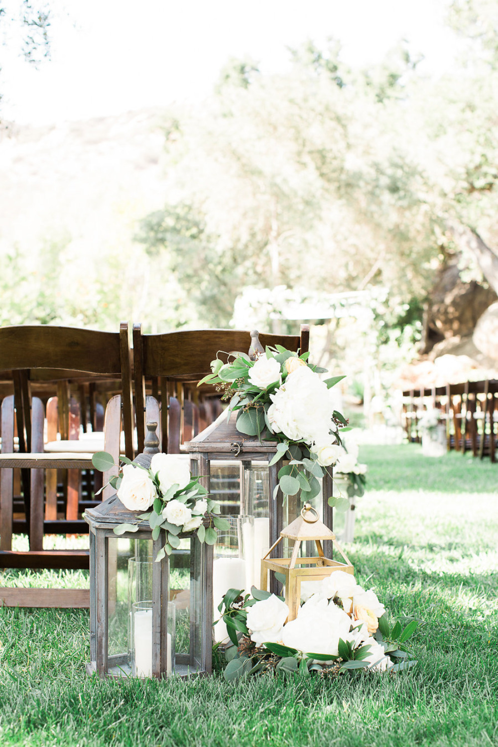 wedding lantern decor with candles and flowers