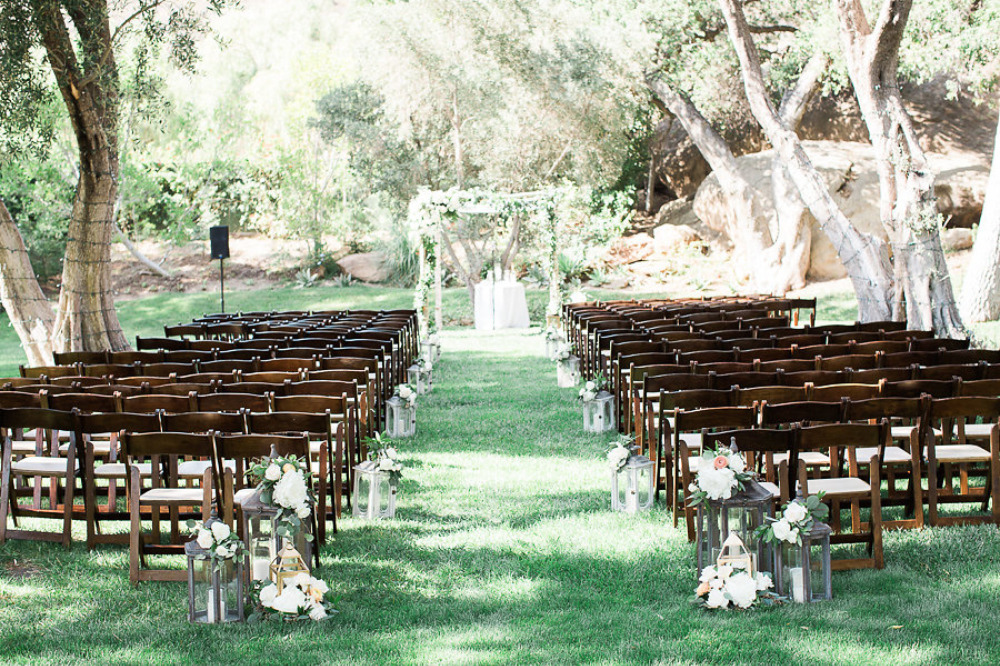 outdoor wedding ceremony venue with lanterns