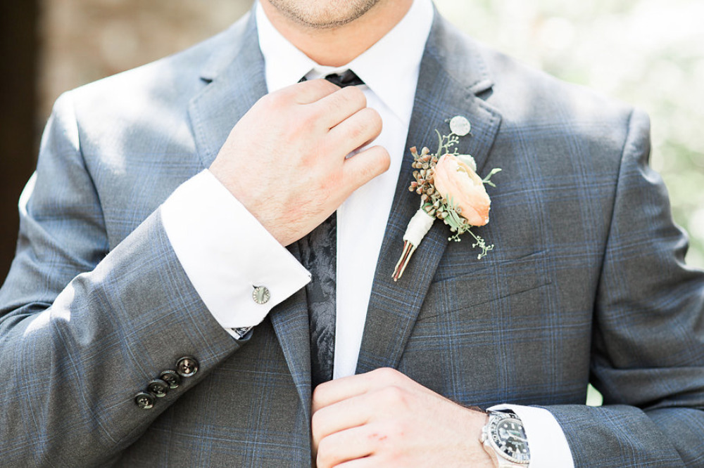 striped blue and grey grooms suit with ranunculus boutonniere