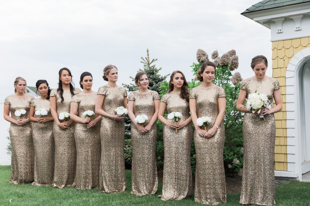 Bridesmaids in sparkly gold dresses