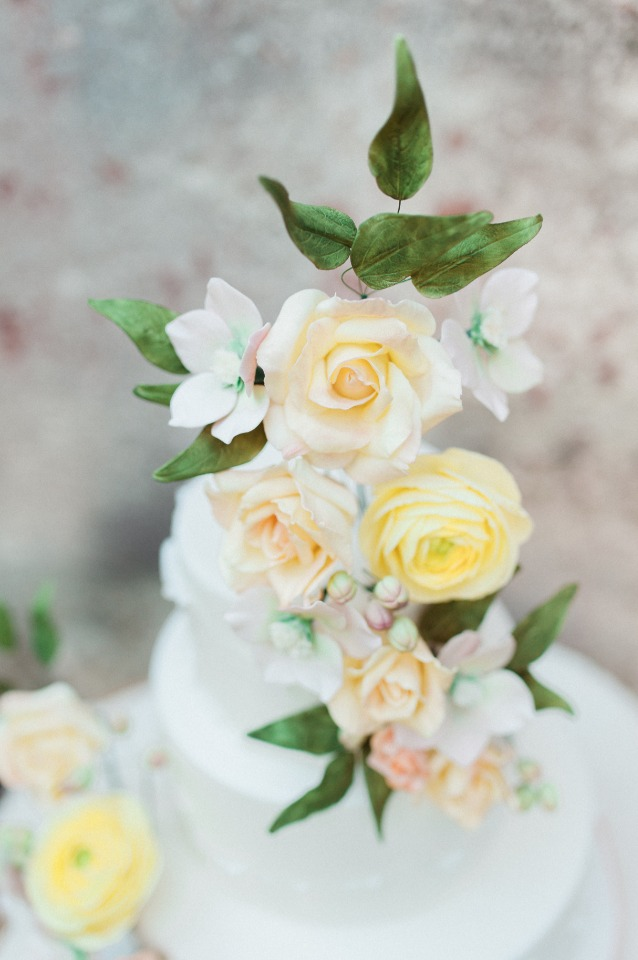 soft yellow and peach flower topped cake