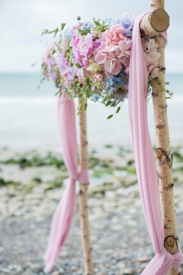 pink and floral wedding arch