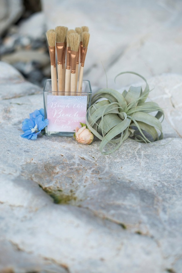 beach brushes to help guests brush away the sand