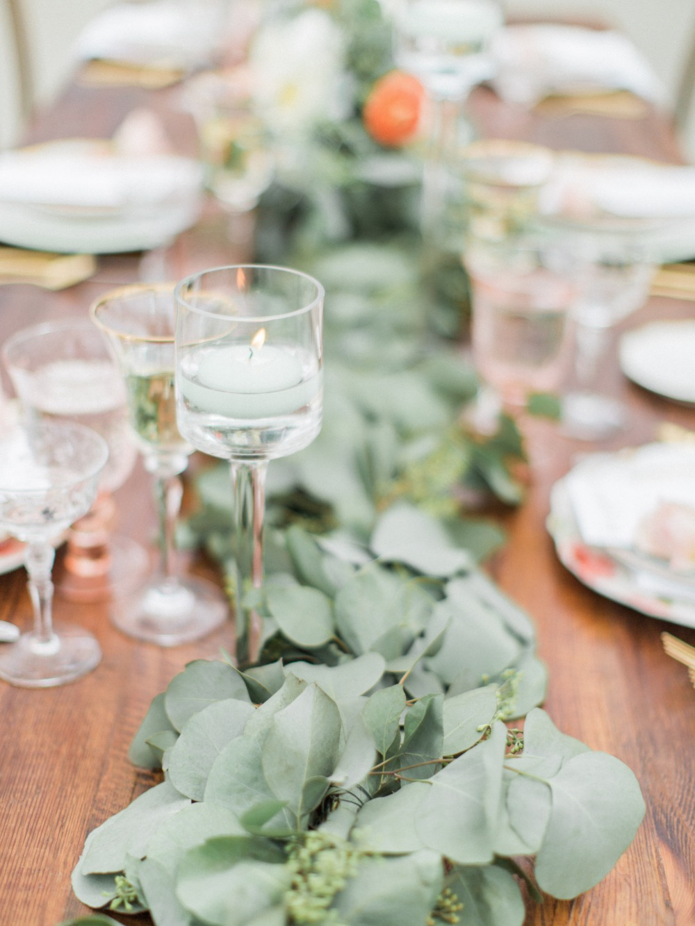 Green garland centerpiece with candles
