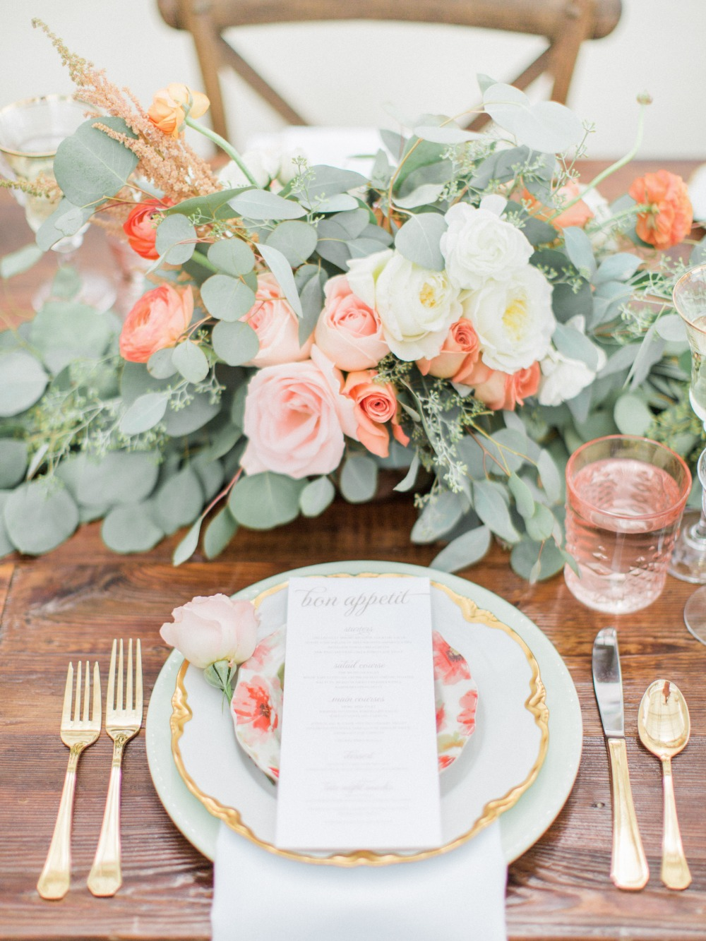 Stylish table decor and gold rimmed plates