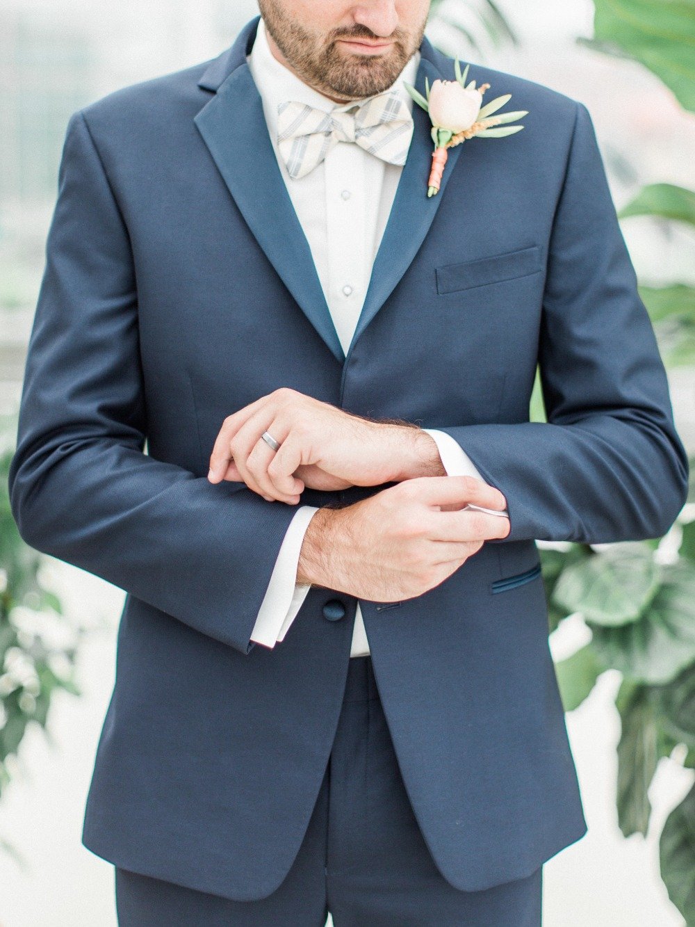 Navy suit with plaid bowtie