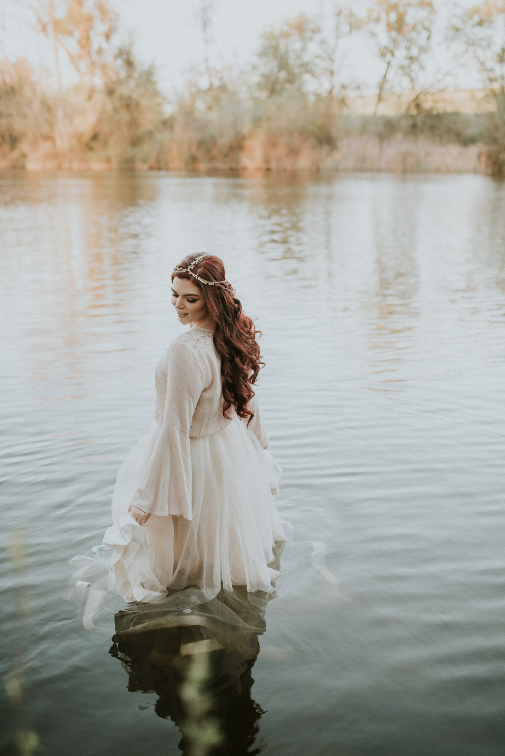 beautiful wedding dress photo in the river