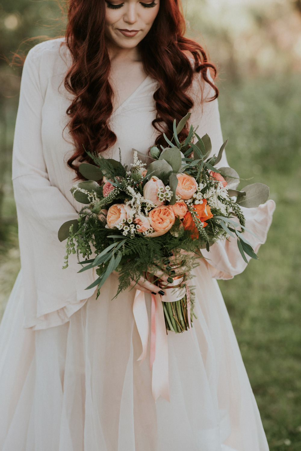 beautiful peach and orange wedding bouquet