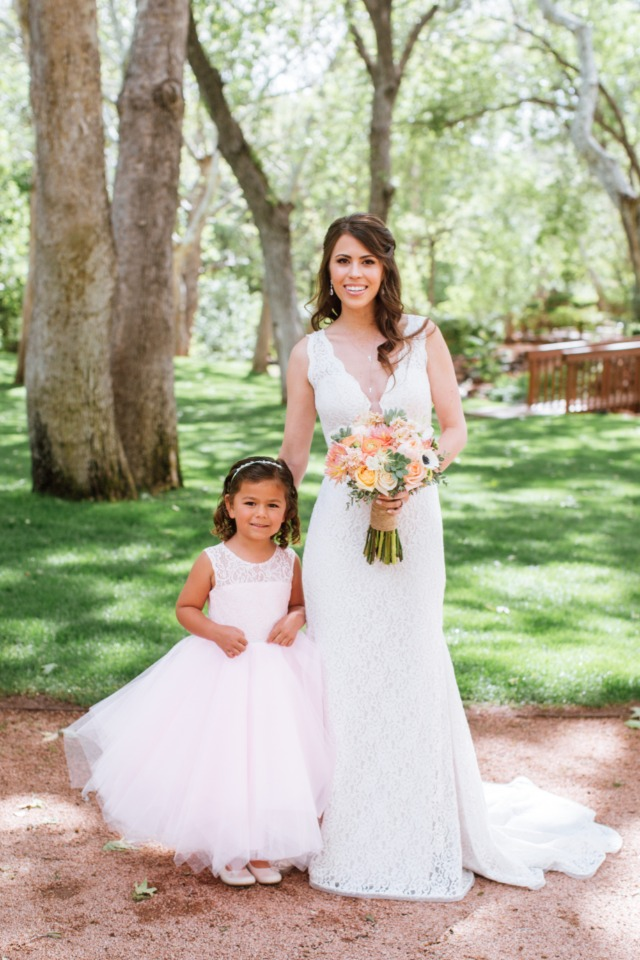 bride and her cute little flower girl