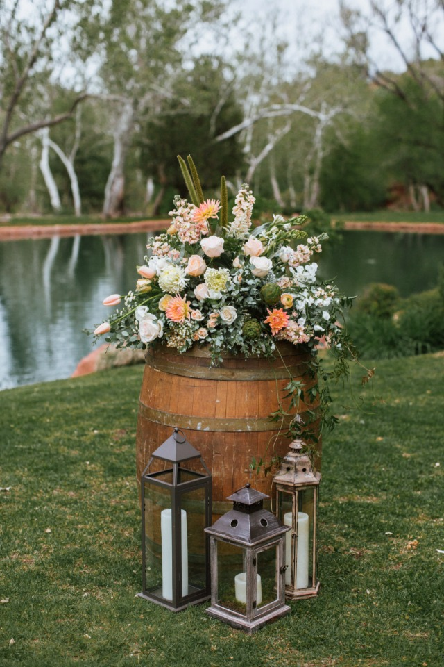 Rustic chic flower arrangement and lantern decor