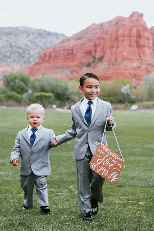 ring bearers in little grey suits