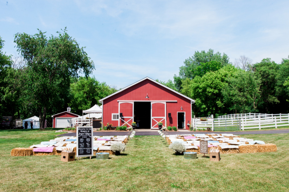 farm barn wedding ceremony with hay bales