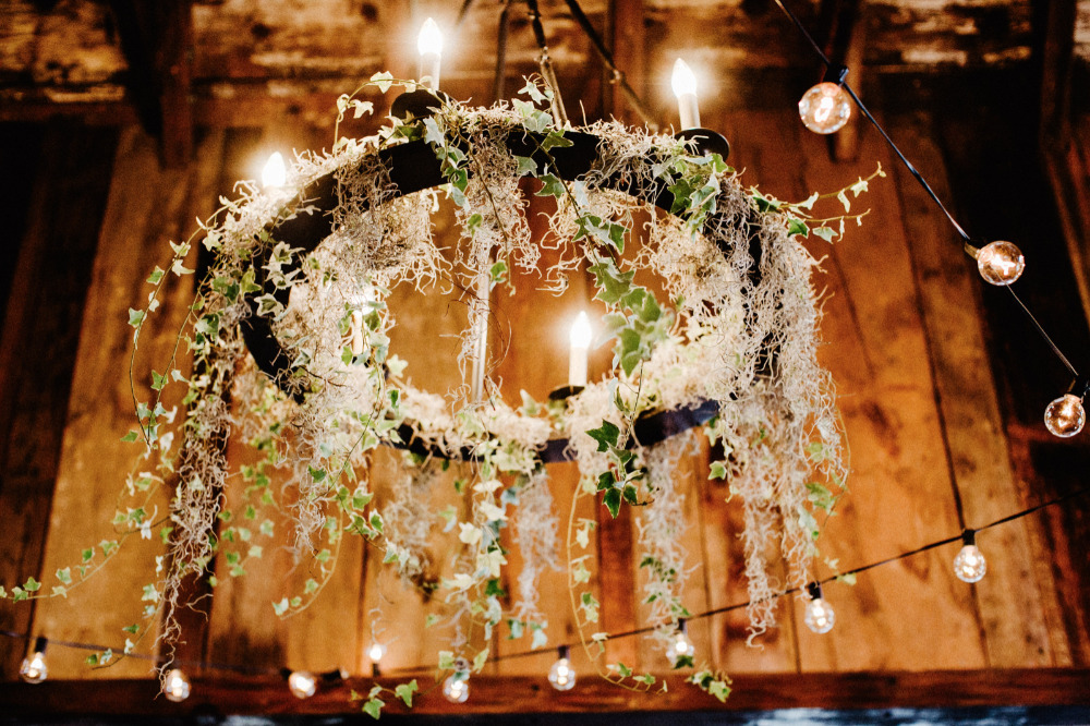 floral and candle chandelier wedding lighting