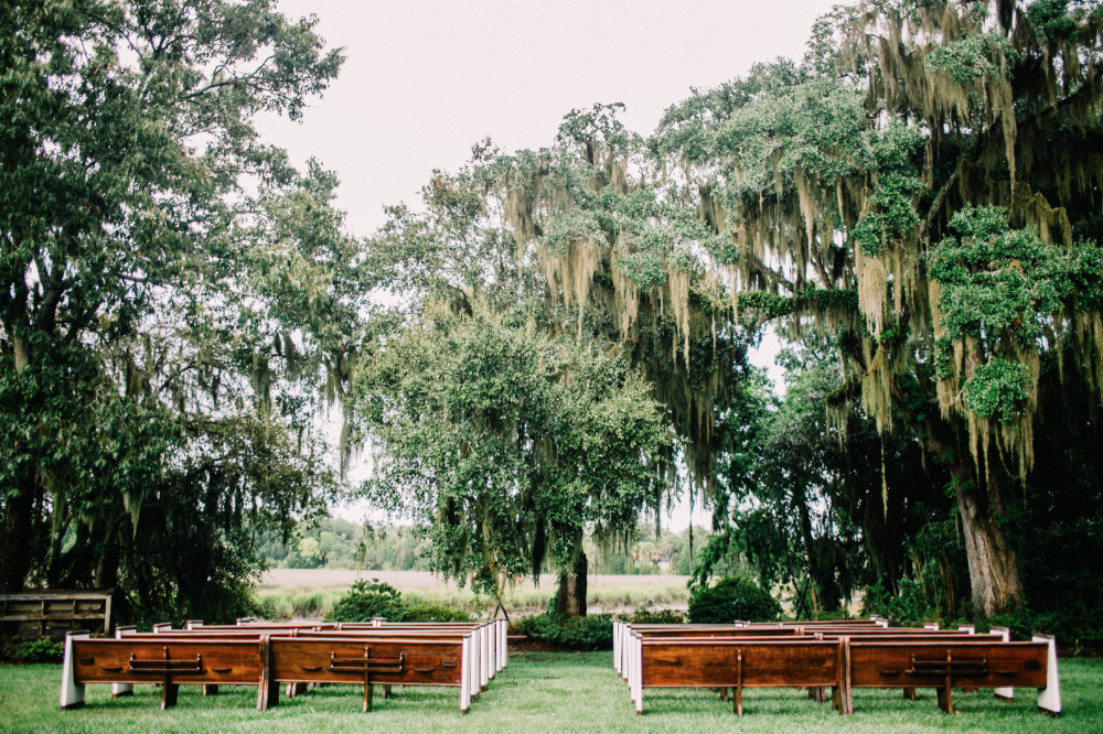 outdoor wedding ceremony with pews