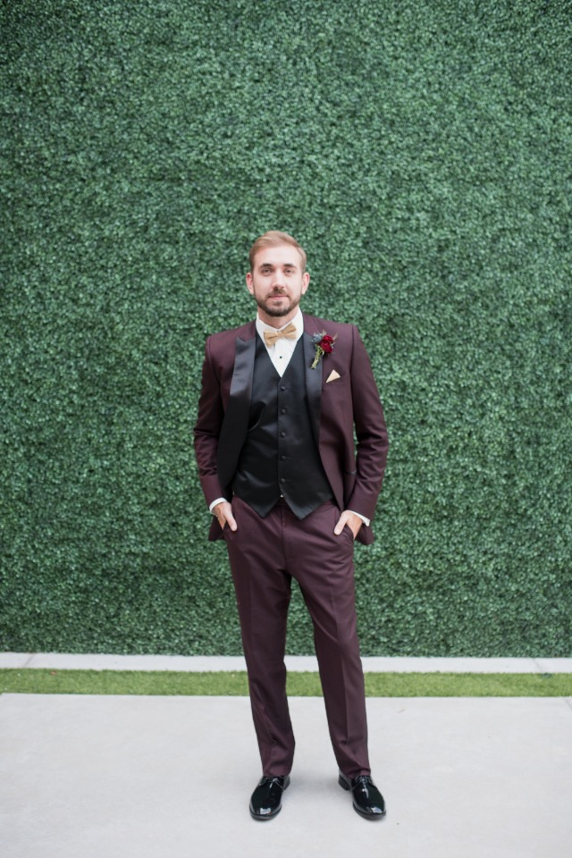 deep maroon and black groom suit