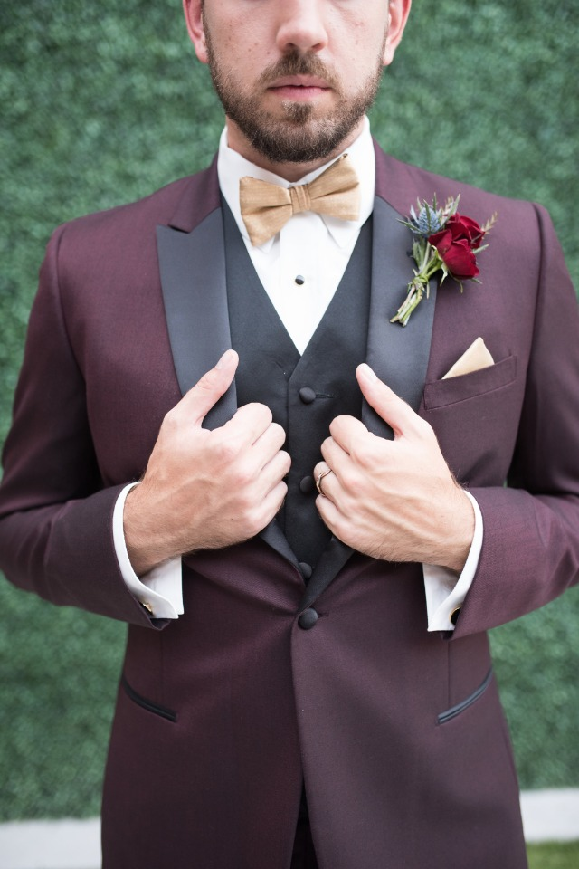 gold bow tie with maroon and black three piece suit