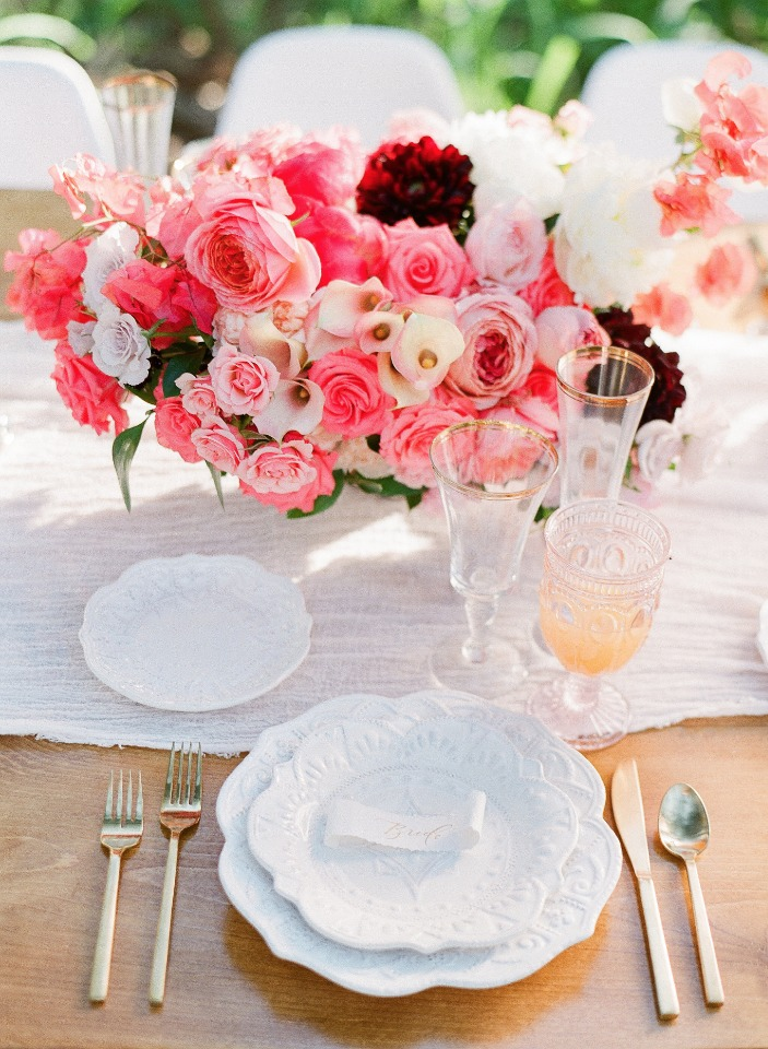 chic pink and gold wedding table with a vintage vibe