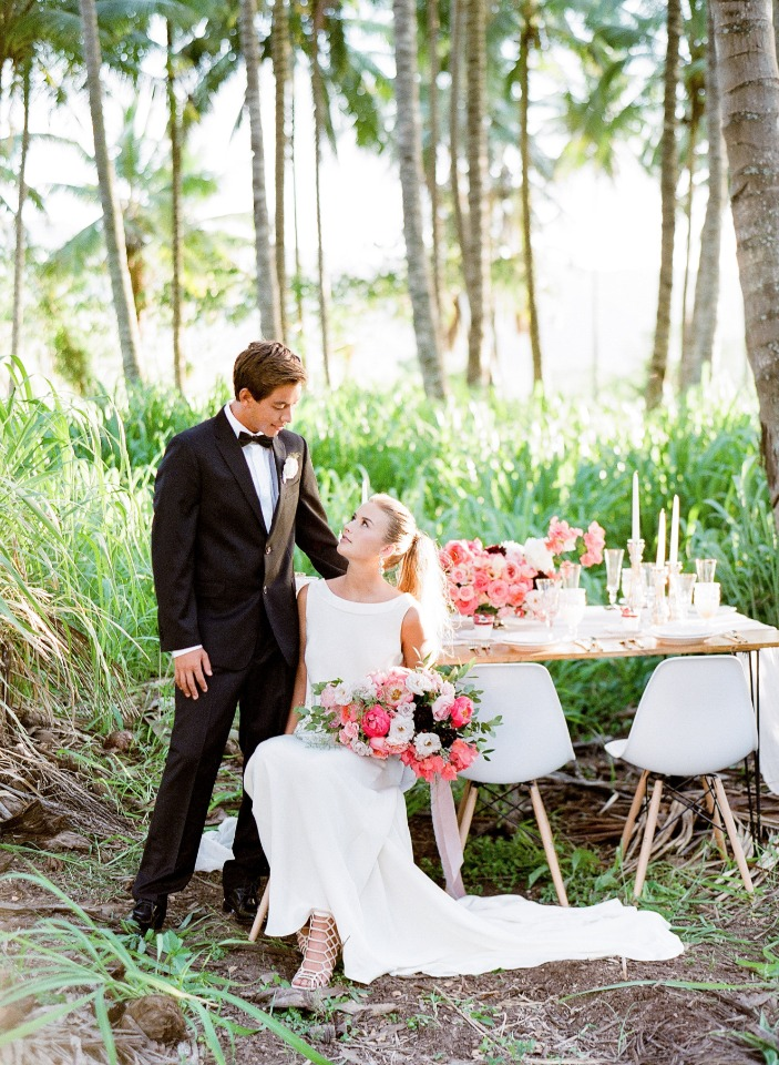 formal bride and groom at tropical forest wedding reception