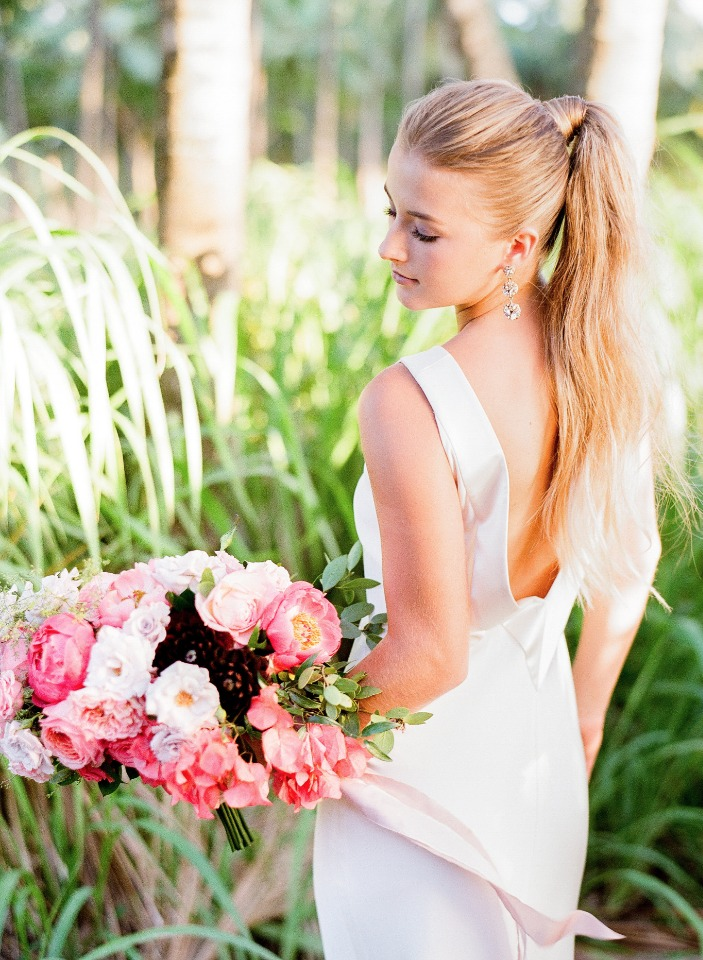 high ponytail and dramatic backed wedding gown