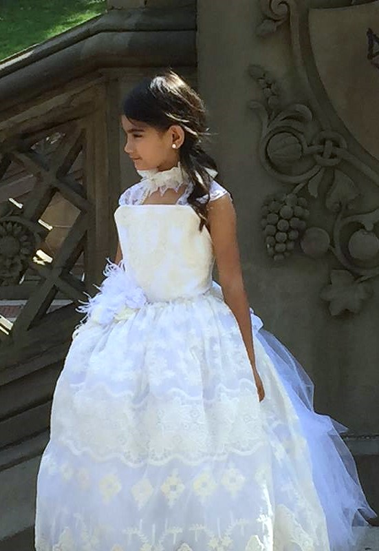 And the flower girl was lovely in white and ivory lace... Limited edition cameo lace dress.